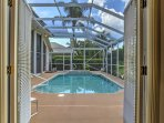 French doors lead to the pool and hot tub.
