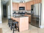 Fully Equipped Open Kitchen with Island Breakfast Bar -  Enjoy Cooking or Grilling Meals with the Family during your...