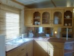 The well equipped kitchen with range style cooker & fridge freezer (shared laundry at reception).