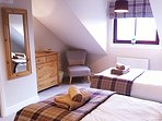 The Berriedale bedroom - a lovely relaxing room with luxury tartan touches and original beam