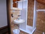 A bathroom with a shower