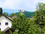 View from the balcony in the summer. The Bled castle is in the background.
