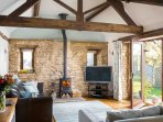 Stunning open plan living room, with lots of character and a cosy log burner
