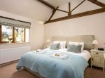Stylish master bedroom, which can be set up as a super king size bed or two single beds
