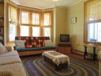 Relax in the parlour at Rockland Cottage