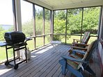 Sit back and relax in the screened in porch