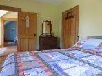First bedroom features queen size bed