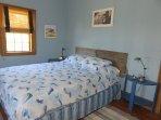 Second bedroom features queen size bed