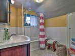 The bathroom offers a shower/tub combo.
