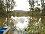 Werri Lagoon (at rear) with private pontoon & canoe for guest use