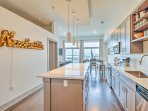 Step inside and enter the fully equipped, gourmet kitchen.