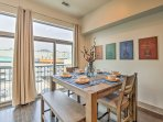 Share your home-cooked feasts at the chic dining table with bench-style seating.