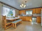 Enjoy your culinary creations at the 4-person dining table.