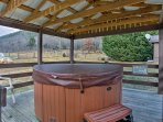 Soak in the private hot tub to soothe your muscles after a hike.