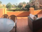 Relax on the sofas overlooking the pool and gardens