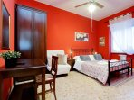 Red room, kingsize bed, ensuite bathroom, large window, ceiling fan (NO A/C in this room)