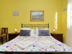 Yellow room, king size bed, large window, A/C