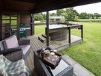Outdoor decking, private hot tub and BBQ area for you all to enjoy those views