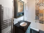 Luxurious bathroom with over bath shower, heated towel rail & loo with a views (if you open window?)