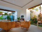 rottan sofa and hanging chair facing the 2nd pool and garden