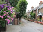 The Whistle Stop with hanging baskets is located in Park Road, a row of Victorian cottages opposite