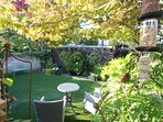 Guest private use of lower terrace and lawn area with bistro table and chairs