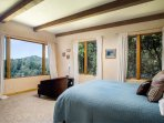 Master bedroom has a view of the ocean from the bed, and an en suite bathroom.