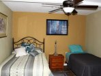 The fourth bedroom has the makings of the kids room with a full and twin bed.