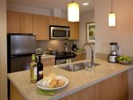 A spacious, open kitchen and modern appliances makes cooking convenient