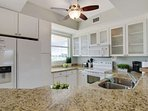 Full sized appliances with granite countertops