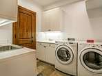 Venture to the lowest level of the home to find the oversized laundry room with utility sink.