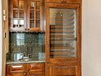 Enjoy the convenience of the wet bar and wine fridge in the living room.
