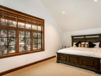 Retreat upstairs to the private master bedroom with king bed and flat screen TV.