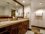 Beautiful master en suite bathroom with double vanity, deep jetted tub and walk in steam shower.