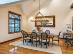 Elegant dining room with seating for 8 guests and views of the slopes.