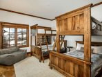 Bedroom 3, located on the lower level, features 2 twin over full bunk beds and a cozy bean bag chair.