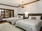 Bedroom 4, located on the lower level, is beautifully furnished with 2 queen beds, flat screen TV and private patio...