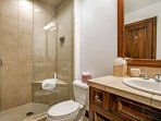 Full guest bath with walk in steam shower, located next to bedroom 3 and across from the theater room.