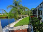 The back yard lined with palms and beautiful calm waters goes on and on