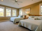 You'll love the natural light flowing into this second floor guest bedroom with two queen sized beds.