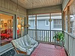 The private screened-in porch is a great space for relaxation.