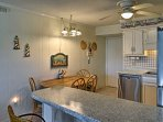 You'll feel right at home as you sit down for dinner with the family at the 4-person dining table.