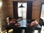 Large rustic table comfortably seats 6 with room for up to 8.