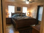 1st floor Master bedroom, king bed, ceiling fan and night stands