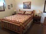 Master Bedroom with a queen bed and private Bath - right.