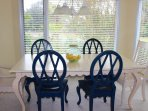 The dining table seats 6. Windows allow sunshine to brighten this living/dining room.