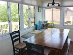 The large farm table has banked seating.