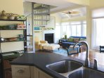 It has Corian counters and is well stocked with all you'll need.