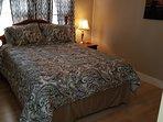 Clean bedroom lines; Comfortable queen size bed.
