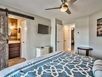 Remodeled master bedroom with barn door leasing to the master bathroom